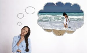 Lady thinking about beach to cure post travel depression